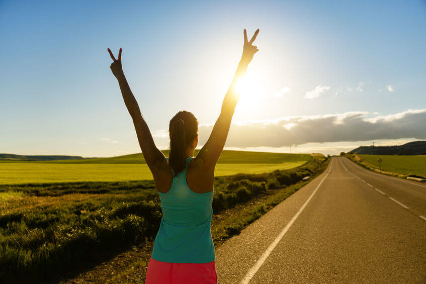 woman celebrating running and training success on